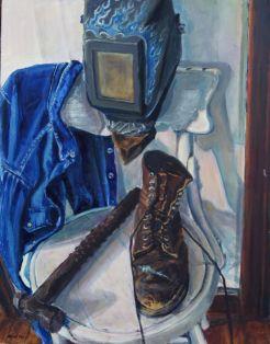 My welding helmet, steel toed boot and ball peen hammer.