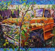 Old orange Ford 2 ton truck in an abandoned implement lot.
