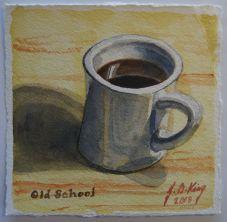Old heavy porcelain coffee mug with black coffee.
