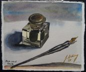 My wife's father's old ink well and a calligraphy pen.