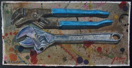 Channel Lock Pliers and Crescent Wrench on spattered background.