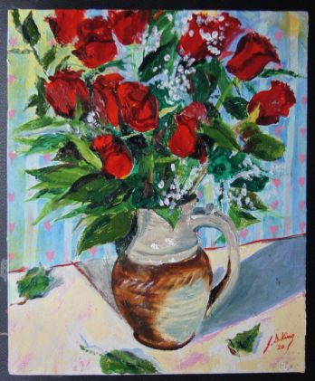 Bouquet of twelve red roses in a high fire stoneware pitcher I made a few years ago in a wood firing.